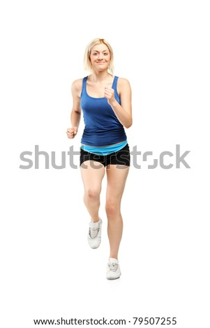 Full length portrait of a female runner isolated on white background
