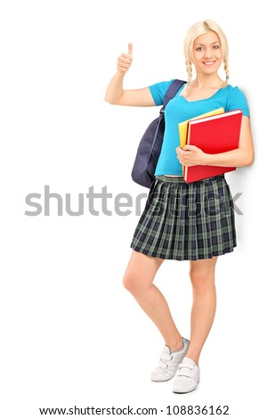 Full length portrait of a female student giving a thumb up, isolated on white background