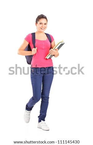 Full length portrait of a female student holding books isolated on white