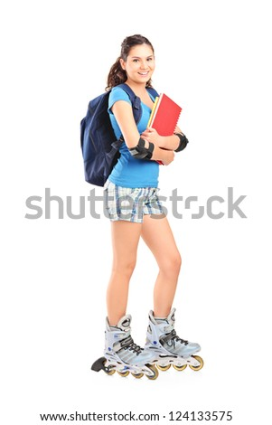 Full length portrait of a female student on roller skates isolated on white background