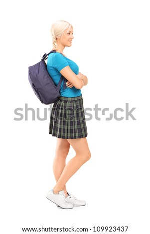 Full length portrait of a female student standing in profile isolated against white background