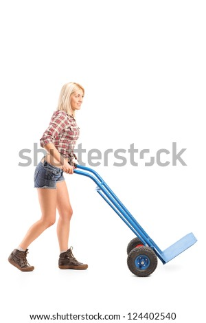 Full length portrait of a female worker pushing an empty hand truck isolated against white background