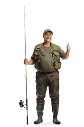 Full length portrait of a fisherman in a uniform standing with a fishing rod and showing thumbs up isolated on white background