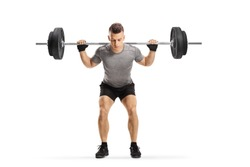 Full length portrait of a fit guy lifting weights isolated on white background