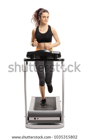 Full length portrait of a fitness girl running on a treadmill isolated on white background