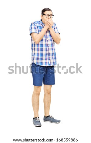 Full length portrait of a frightened young man looking isolated on white background