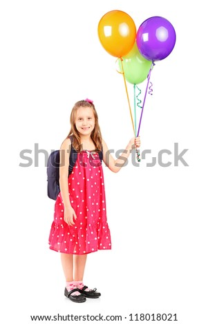 Full length portrait of a girl holding a bunch of balloons isolated on white background