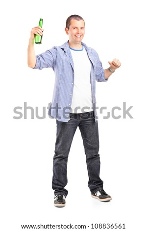 Full length portrait of a guy holding a beer bottle isolated on white background