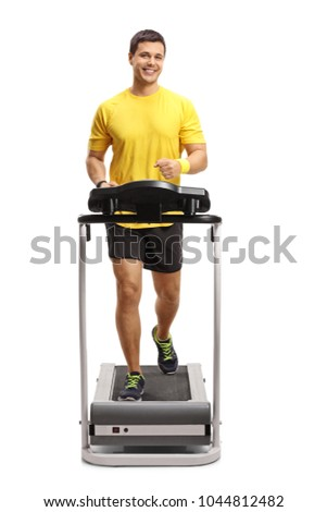 Full length portrait of a guy running on a treadmill isolated on white background