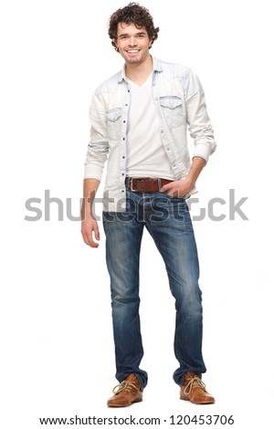 Full length portrait of a handsome young man smiling. Isolated on white background. He has his hand in his pocket