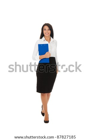 Full length portrait of a happy business woman with folder isolated over white background