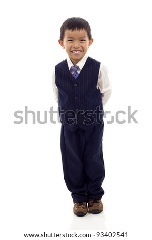 Full length portrait of a happy little Asian boy standing isolated over white background