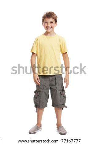 Full length portrait of a happy little boy standing isolated over white background