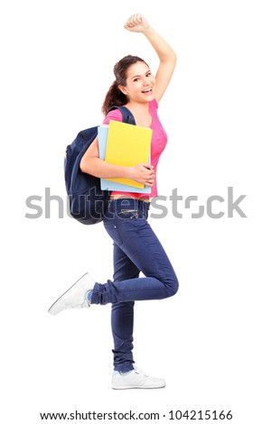 Full length portrait of a happy schoolgirl holding notebooks isolated against white background