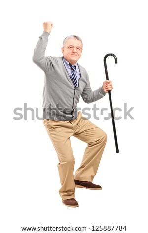 Full length portrait of a happy senior man holding a cane and gesturing happiness isolated on white background
