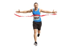 Full length portrait of a happy young man finishing a marathon race on the finish line isolated on white background