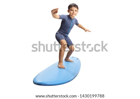 Full length portrait of a little boy surfing on a surfboard isolated on white background #1430199788