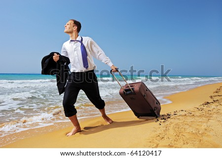 Full length portrait of a lost businessman carrying a suitcase at the beach