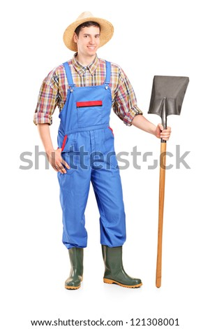 Full length portrait of a male agricultural worker holding a shovel isolated on white background