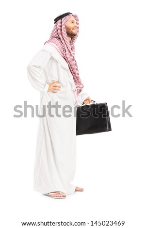 Full length portrait of a male arab person with suitcase posing isolated on white background
