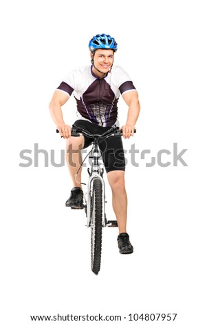Full length portrait of a male bicyclist posing on a bicycle isolated against white background
