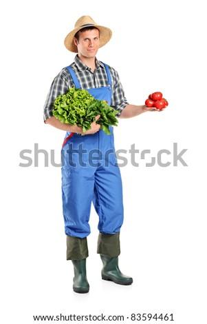 Full length portrait of a male farmer holding vegetables isolated on white background