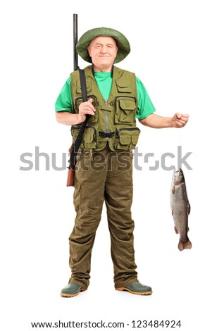 Full length portrait of a male hunter with rifle holding a fish isolated on white background