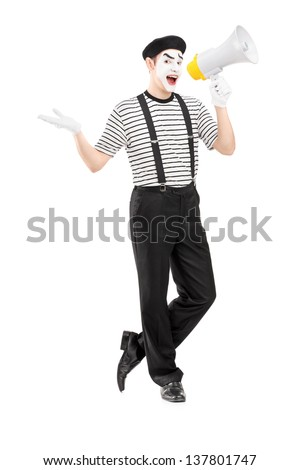 Full length portrait of a male mime artist speaking at loudspeaker and looking at camera isolated on white background