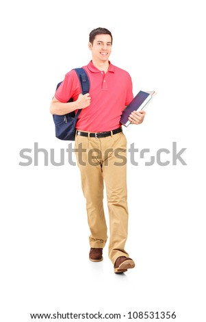 Full length portrait of a male student walking, isolated on white background