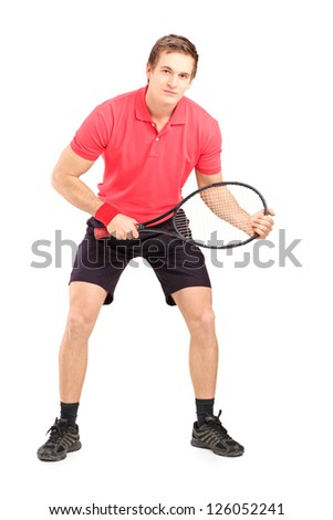 Full length portrait of a male tennis player holding a racket isolated on white background