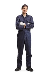 Full length portrait of a male worker in a uniform smiling and posing with crossed arms isolated on white background