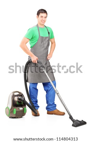 Full length portrait of a man cleaning with vacuum cleaner isolated on white background