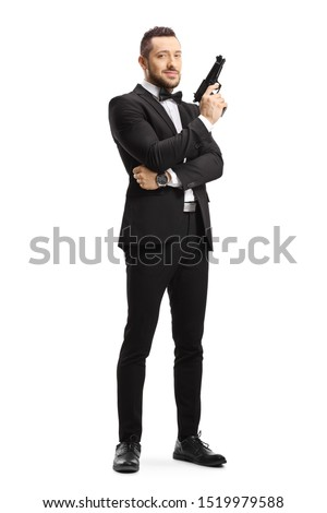 Full length portrait of a man in a suit holding a gun isolated on white background