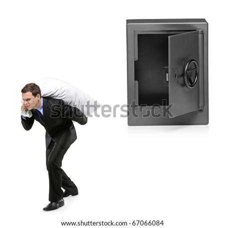 Full length portrait of a man stealing a money bag from a deposit safe isolated on white background