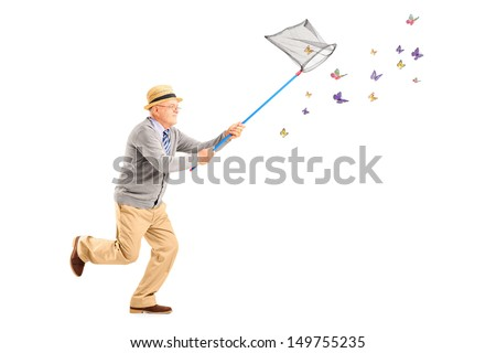 Full length portrait of a mature man running and catching butterflies with net isolated on white background