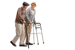 Full length portrait of a mature man with a walker and another man with a cane isolated on white background