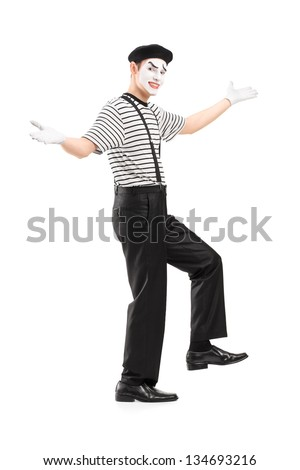 Full length portrait of a mime dancer gesturing with hands, isolated on white background