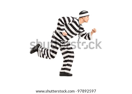 Full length portrait of a prisoner escaping isolated on white background - stock photo