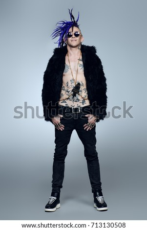 Full length portrait of a punk rock musician posing at studio. Youth alternative culture.  #713130508