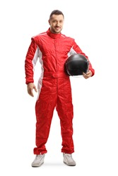 Full length portrait of a racer in a red uniform holding a helmet and smiling isolated on white background