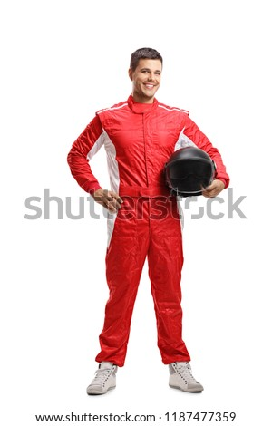 Full length portrait of a racer standing and holding a helmet isolated on white background