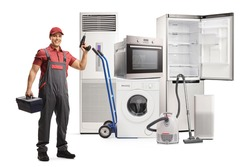 Full length portrait of a repairman with a tool box and a drill standing in front of home appliances isolated on white background