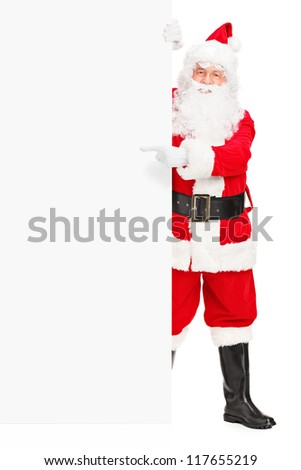 Full length portrait of a Santa claus posing next to a blank billboard and pointing isolated on white background - stock photo