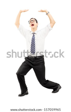 Full length portrait of a scared young man protecting from above with his hands isolated on white background
