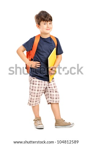Full length portrait of a school boy with backpack holding a notebook isolated on white background