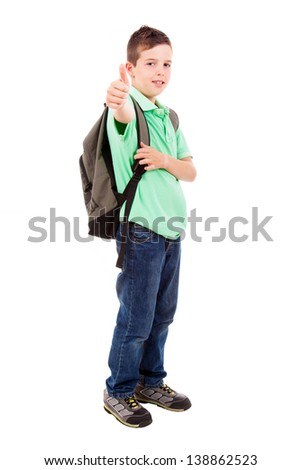 Full length portrait of a school boy with thumb up gesture, isolated on white background