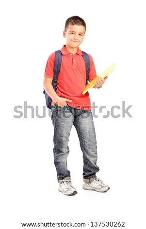 Full length portrait of a schoolboy with backpack holding a notebook isolated on white background