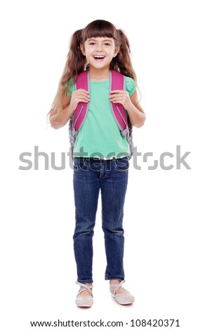 Full length portrait of a schoolgirl standing on white background