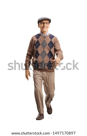 Full length portrait of a senior gentleman walking towards the camera isolated on white background