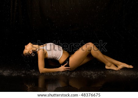 Full length portrait of a sexy woman in water studio